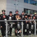 The band gathered outside the Amex stadium