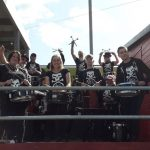 The band standing proudly next to the commentator's box at Lewes football ground. Pretty much the same as the last match!