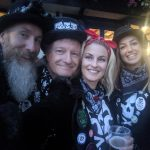 Four members of SkullDrummery grinning excitedly outside the Stand Up Inn at Lindfield!
